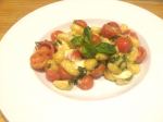 Gnocchi sautéed with cherry tomato, mozzarela and basil
